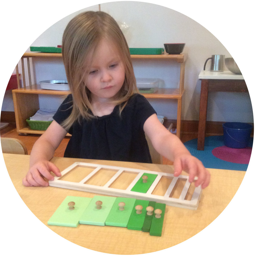 This young toddler is concentrating on a work that introduces concepts of shape, color, and size.