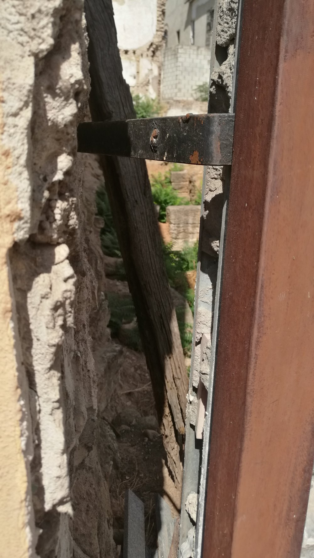 Peering through the walls to the excavation site