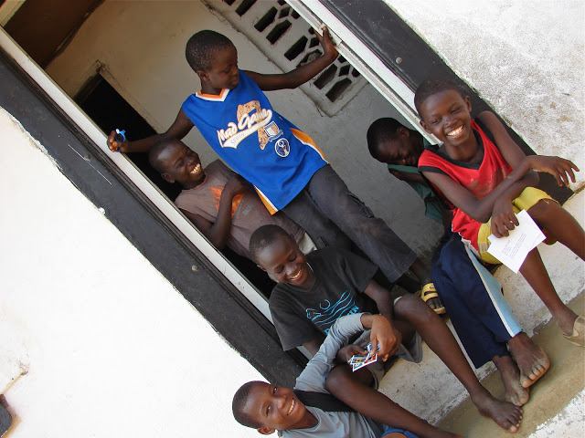 Some of the boys reading letters from their sponsor families in front of the boys' dorm. I love their smiles!