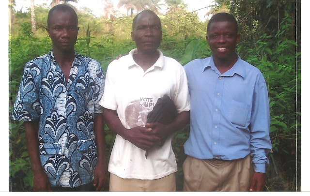 From left to right: Abraham (the pastor of the Harbel church), David Bweh, and Emmanuel.