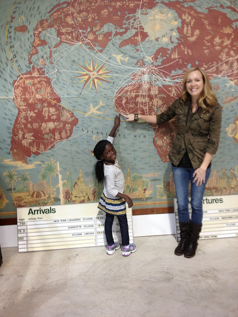 Eve and her mommy in the US, pointing back to where it all began.
