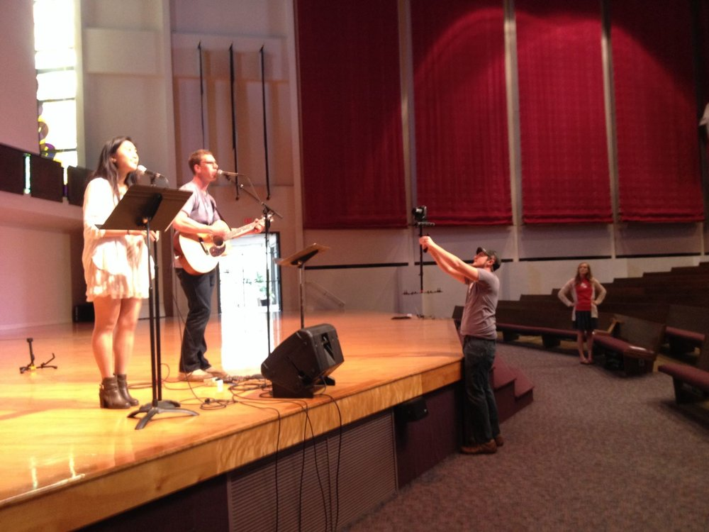 Worship practice and videography coverage of the event.