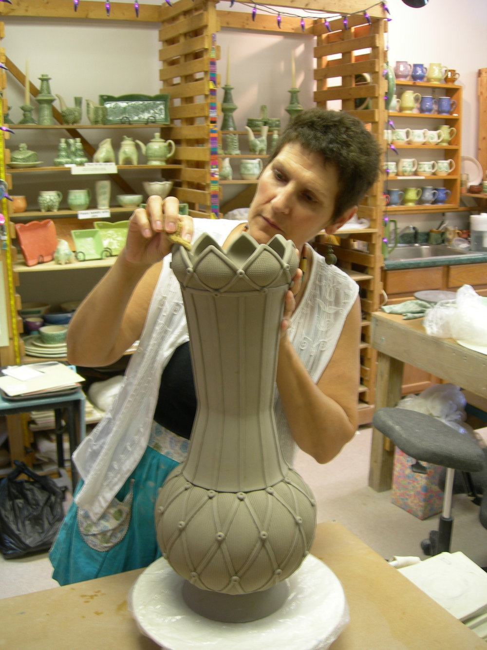 Sandi working on a large slab built vase