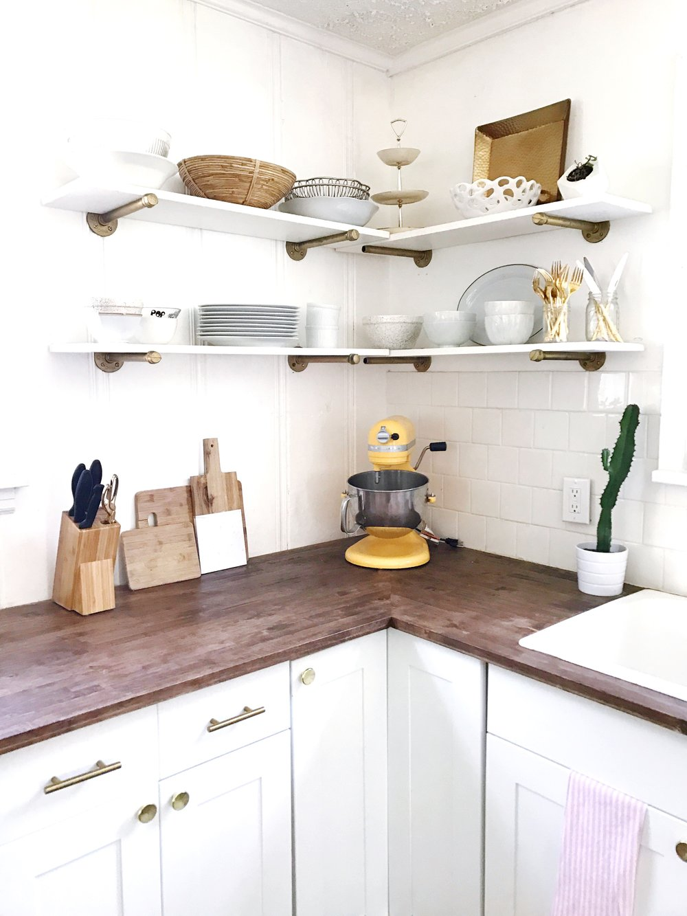 we carried the gold accents through out the house with the hardware on the cabinets. It took me a while to find the perfect ones that weren't super expensive:) I found these on Amazon!