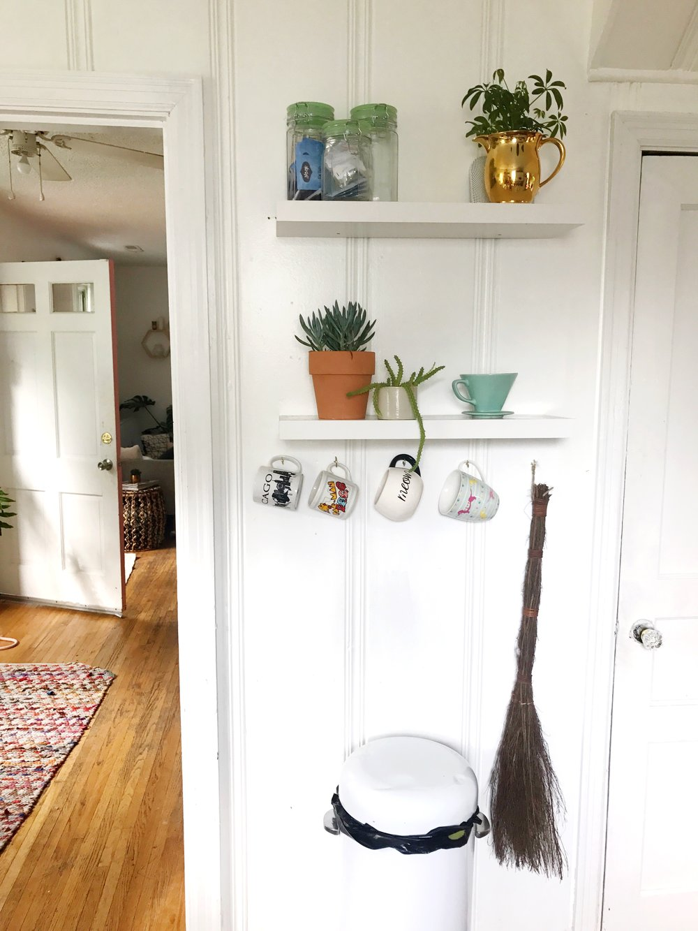 We added these floating shelves a few months ago. They are the perfect place for plants and coffee accessories :)