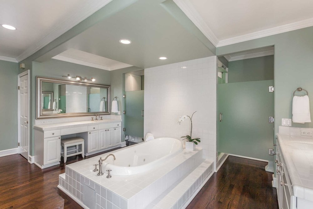 The luxurious master spa bathroom with an oversized soaking tub.
