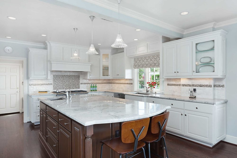 The chef-caliber kitchen is replete with high-end appliances, including a beautiful La Cornue range, center island, abundance of cabinetry and pair of butler's pantries.