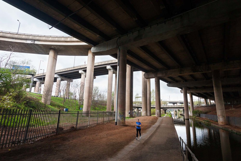 Runner underneath the Gravelly Hill Interchange on the M6 at Birmingham - better known as Spaghetti Junction
