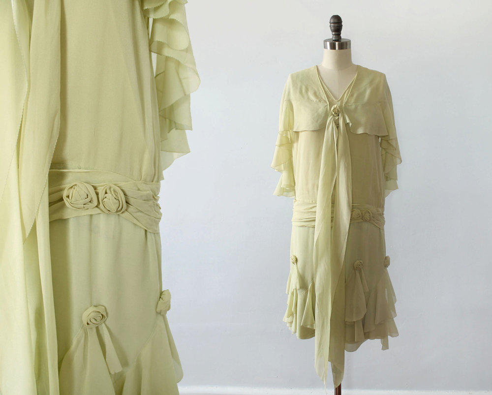 Pistachio green silk chiffon dress with silk rosettes. 1920s.