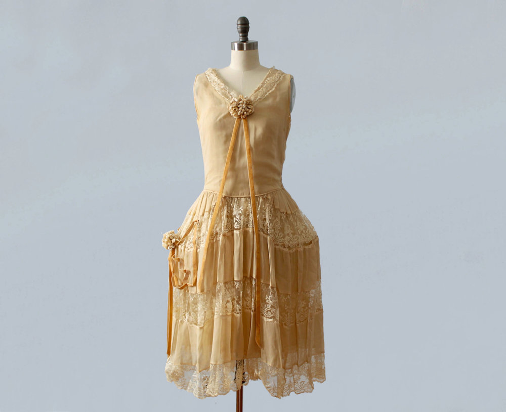 Silk and lace robe de style dress with pannier hoop skirt, flower clusters, and velvet ribbon trim. 1920s.