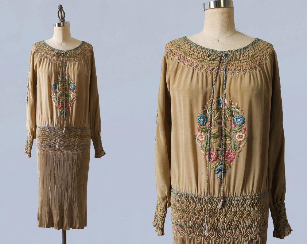 Silk peasant dress with tightly pleated skirt and embroidery. 1920s.