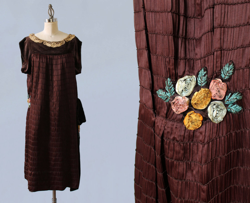 Brown silk tightly pleated dress with silk flower cluster. 1920s.