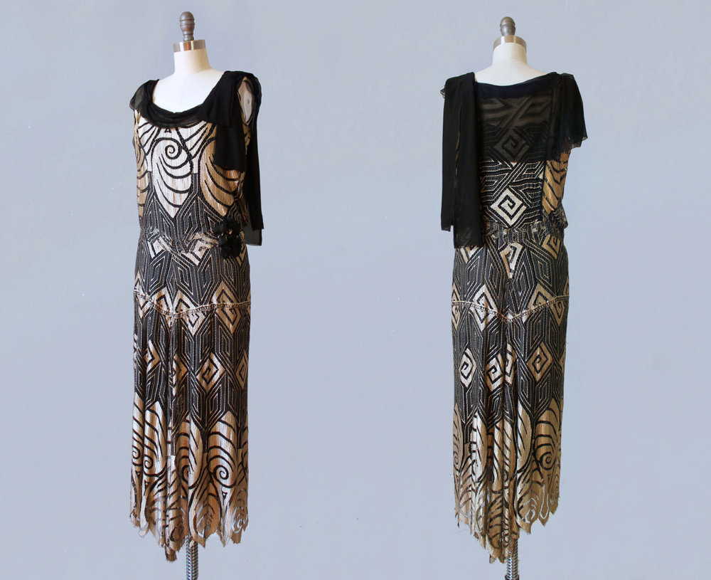 Black net and metallic gold silk dress with Art Deco shell motif. 1920s.