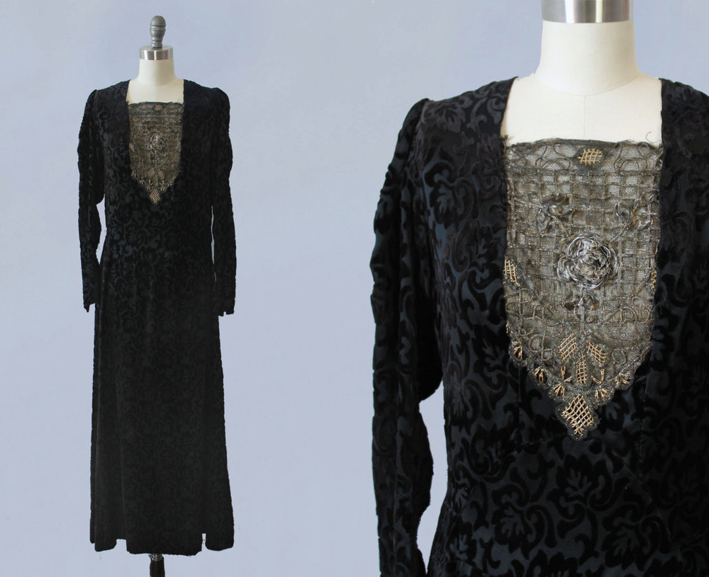 Black velvet dress with gold metalwork bib. 1920s.