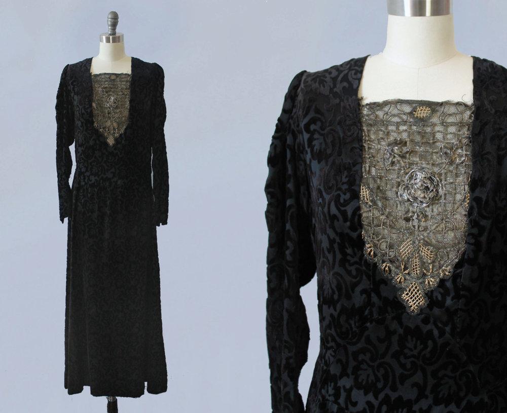 Black velvet dress with gold metalwork bib. 1920s.