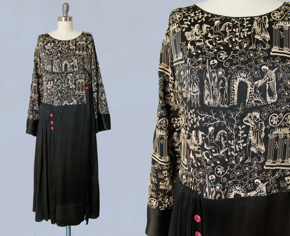 Black silk dress with Greek myth embroidery. Orpheus, infant Zeus and cornucopia, ionic columns, etc depicted. Maid Marion Dresses / Paris / New York. 1920s.