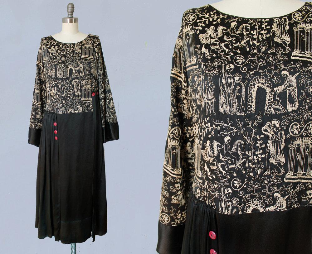 Black silk dress with Greek myth embroidery. Orpheus, infant Zeus and cornucopia, ionic columns, etc depicted. Maid Marion Dresses / Paris / New York. 1920s.
