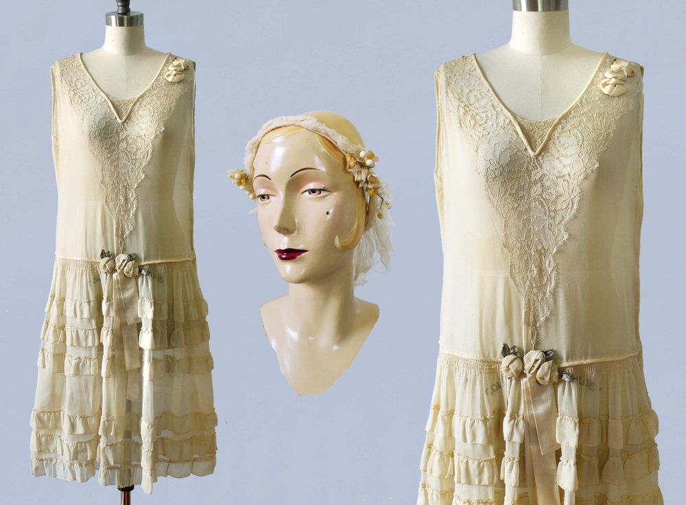 Silk and lace wedding dress with silk rosettes and wax flower headpiece. 1920s.