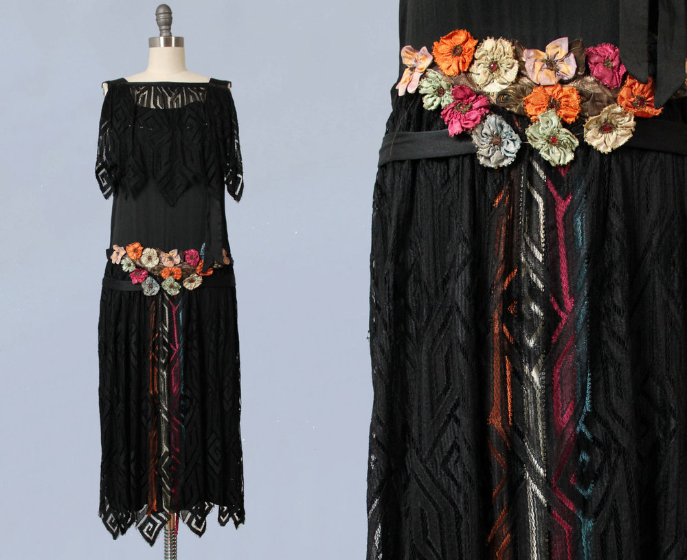 Silk satin and lace dress with art deco motifs, colored ribbon, and silk flowers. 1920s.