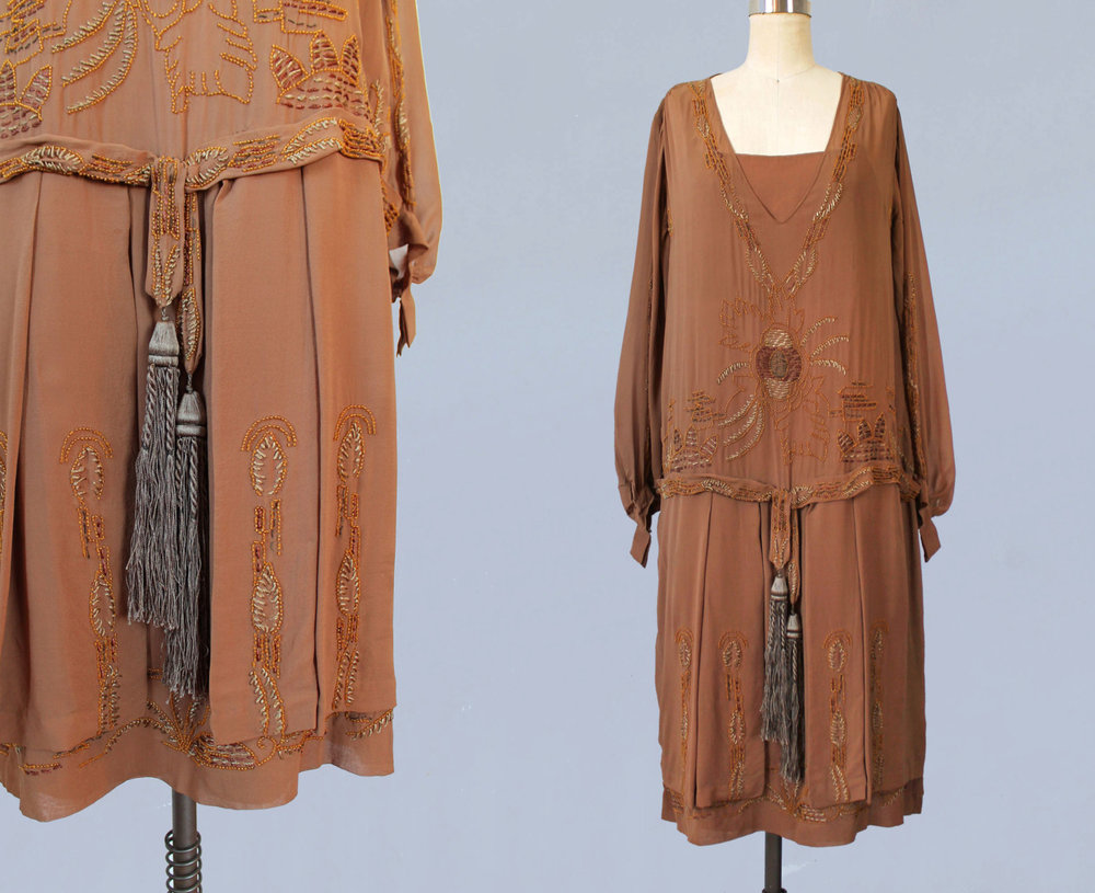 Brown silk dress with embroidery and tassel belt. 1920s.