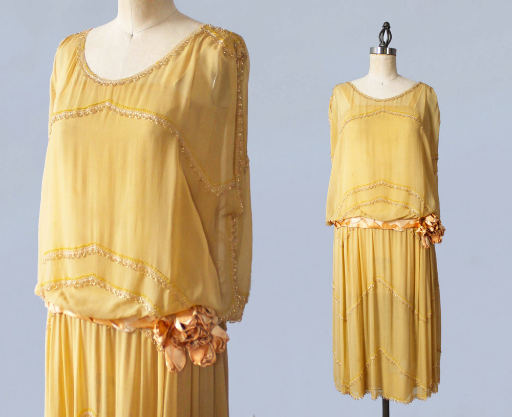 Beaded yellow silk dress with velvet flower. 1920s.