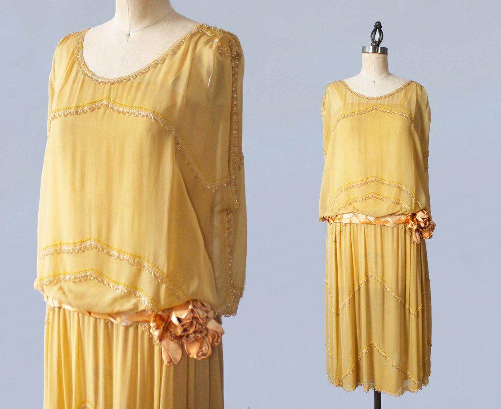 Beaded yellow silk dress with velvet flower. 1920s.