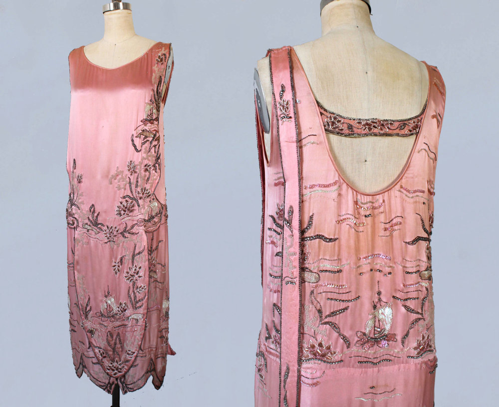 Pink silk satin dress with beading and embellishments in an oceanic motif including whales and ships. 1920s.