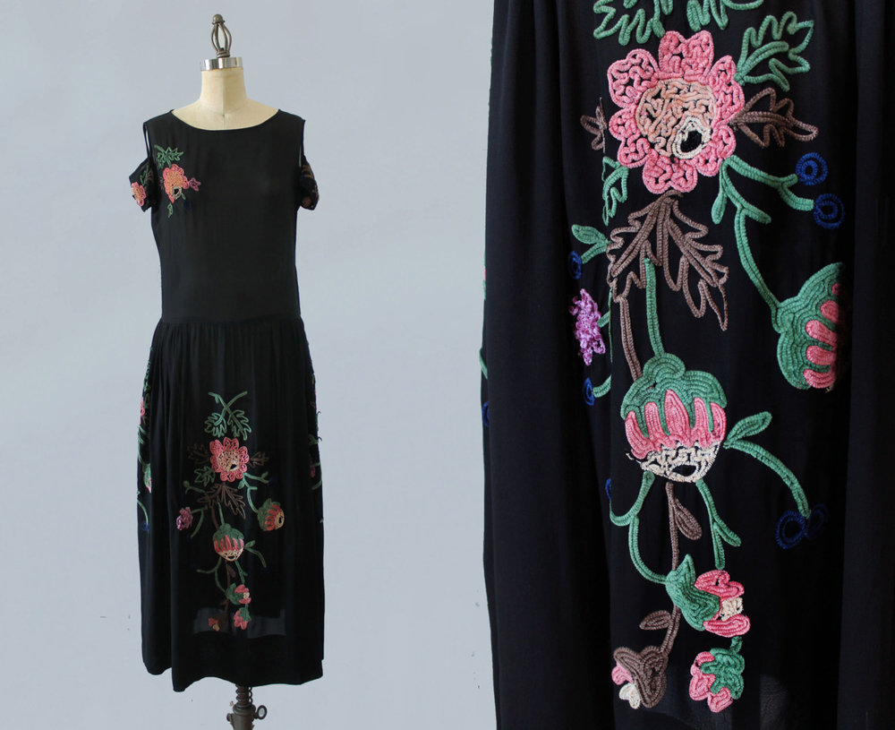 Black embroidered dress with cutout shoulders. 1920s.