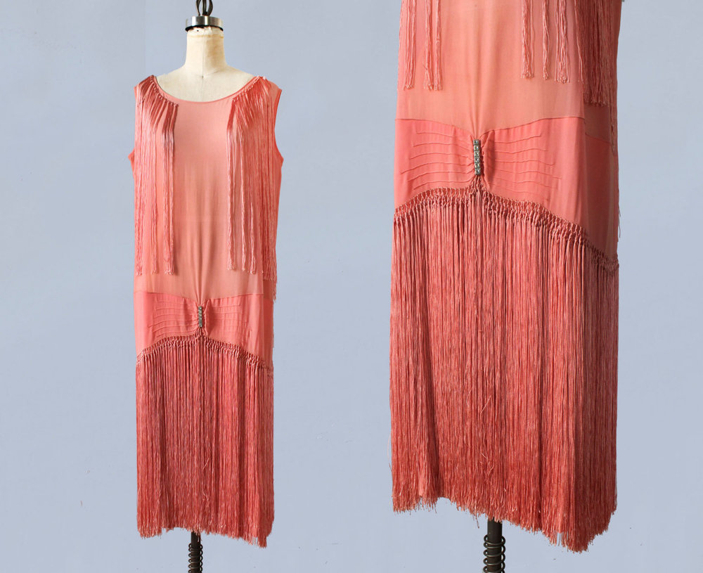 Pink silk flapper dress with fringe. 1920s.