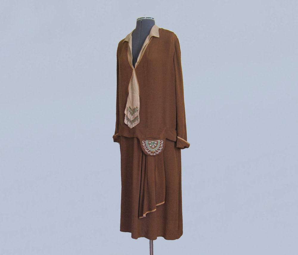 Brown silk dress with embroidery. 1920s.