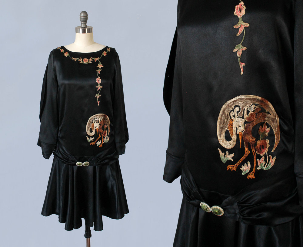 Black satin dress with embroidery and bird motif. 1920s.