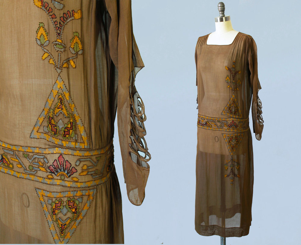 Sheer cotton dress with hand painted Egyptian revival motifs and knotted accents. Unusual cutout sleeves. 1920s.