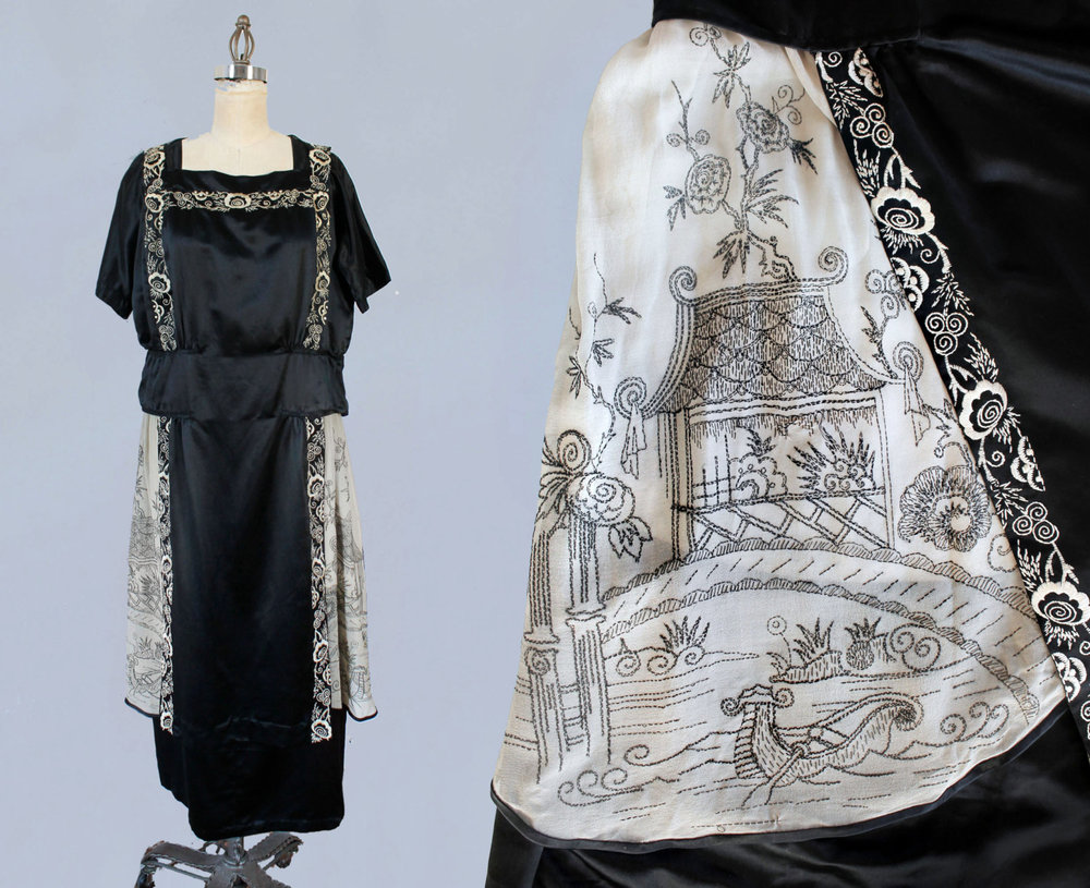 Black satin dress with intricately embroidered Asian scenes. 1920s.
