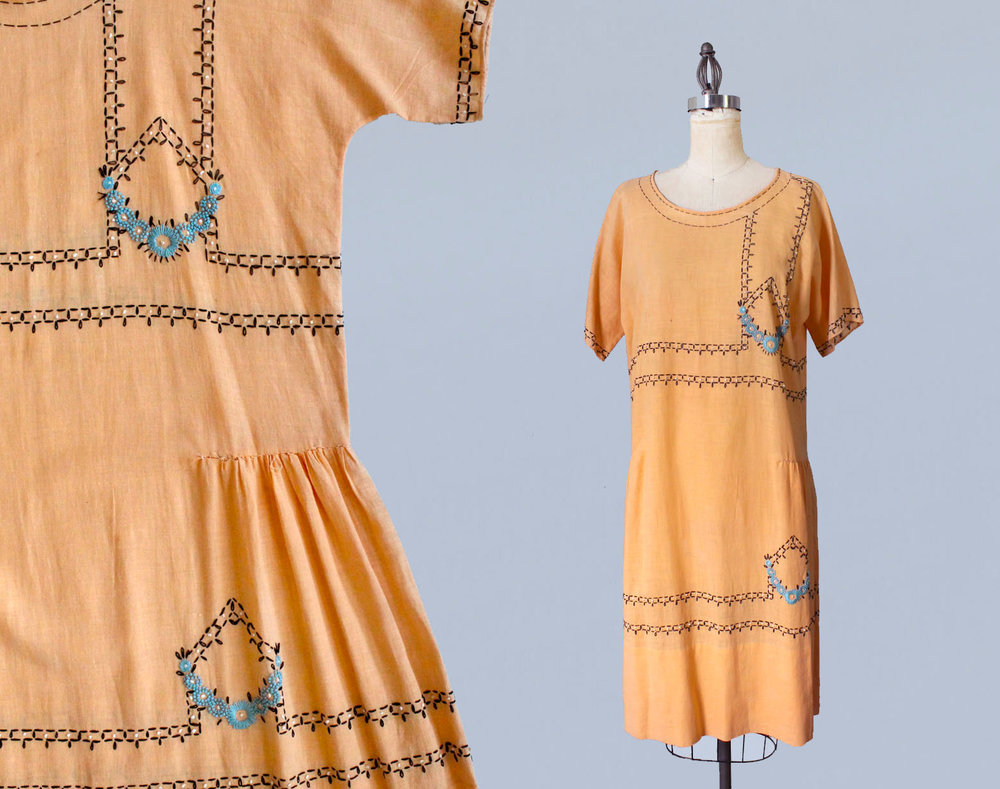 Orange embroidered cotton kit dress. 1920s.