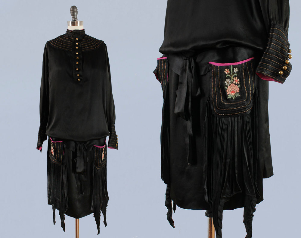 Black silk satin dress with pleating, hot pink trim, and embroidered pockets. 1920s.