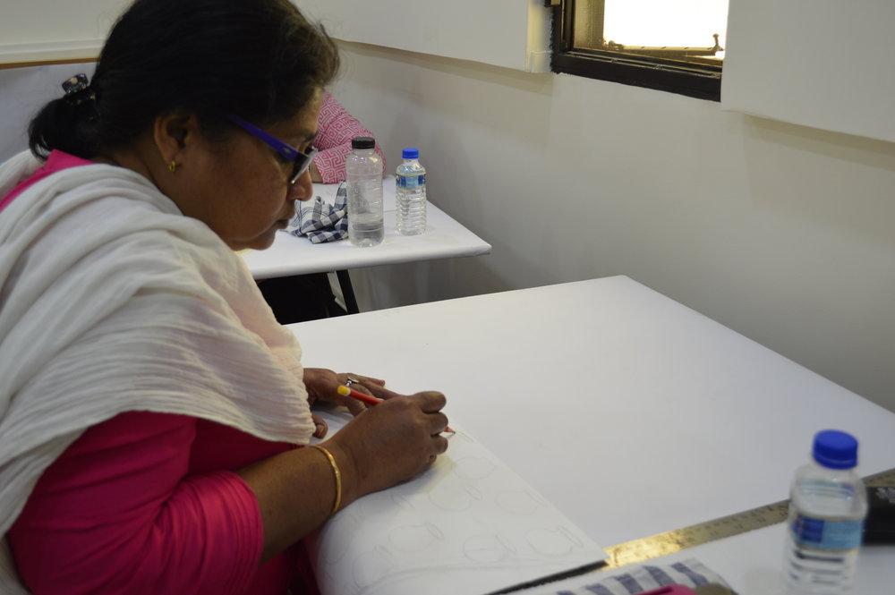 Merin Moli busy focusing on her drawings.