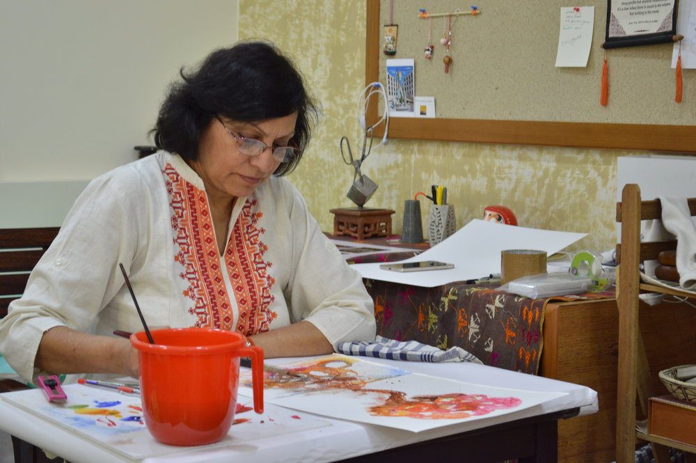 Kavita Nayar at work , building layers of paint.
