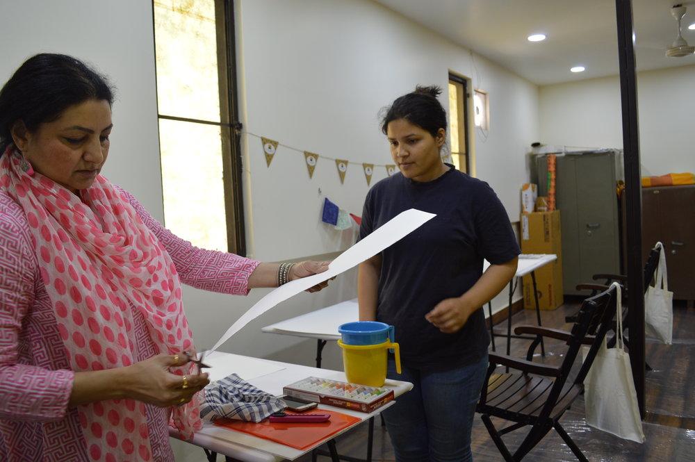 Ritu Kamath at work along with a volunteer.