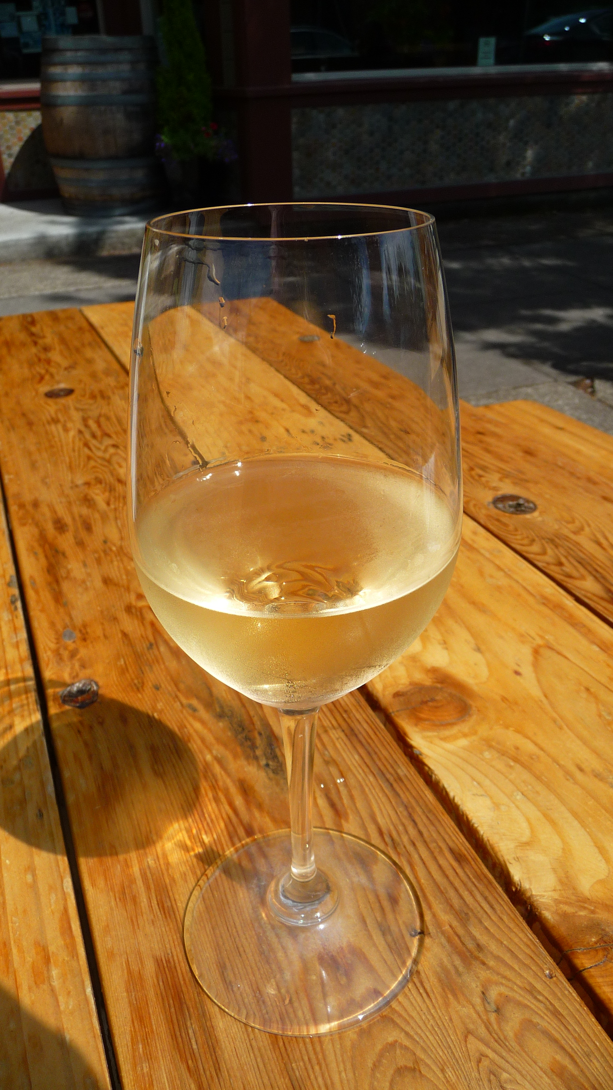 A glass of Vivanco Tempranillo Blanco outside at The Portland Bottle Shop