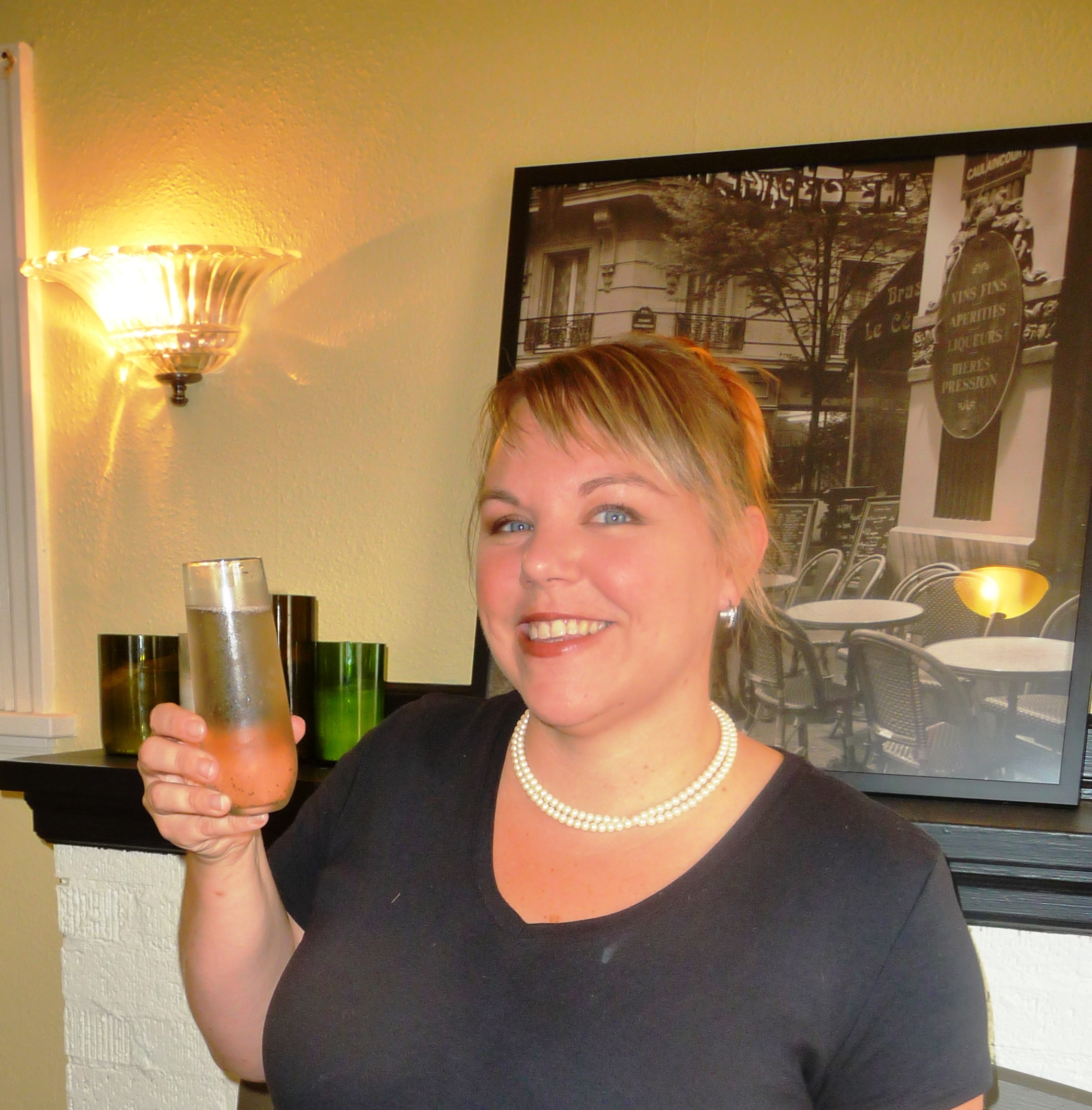 Keri Gallagher, owner of C'est La Vie, showing off the Provence, an elegant mimosa made with a Spanish Cava and lavender