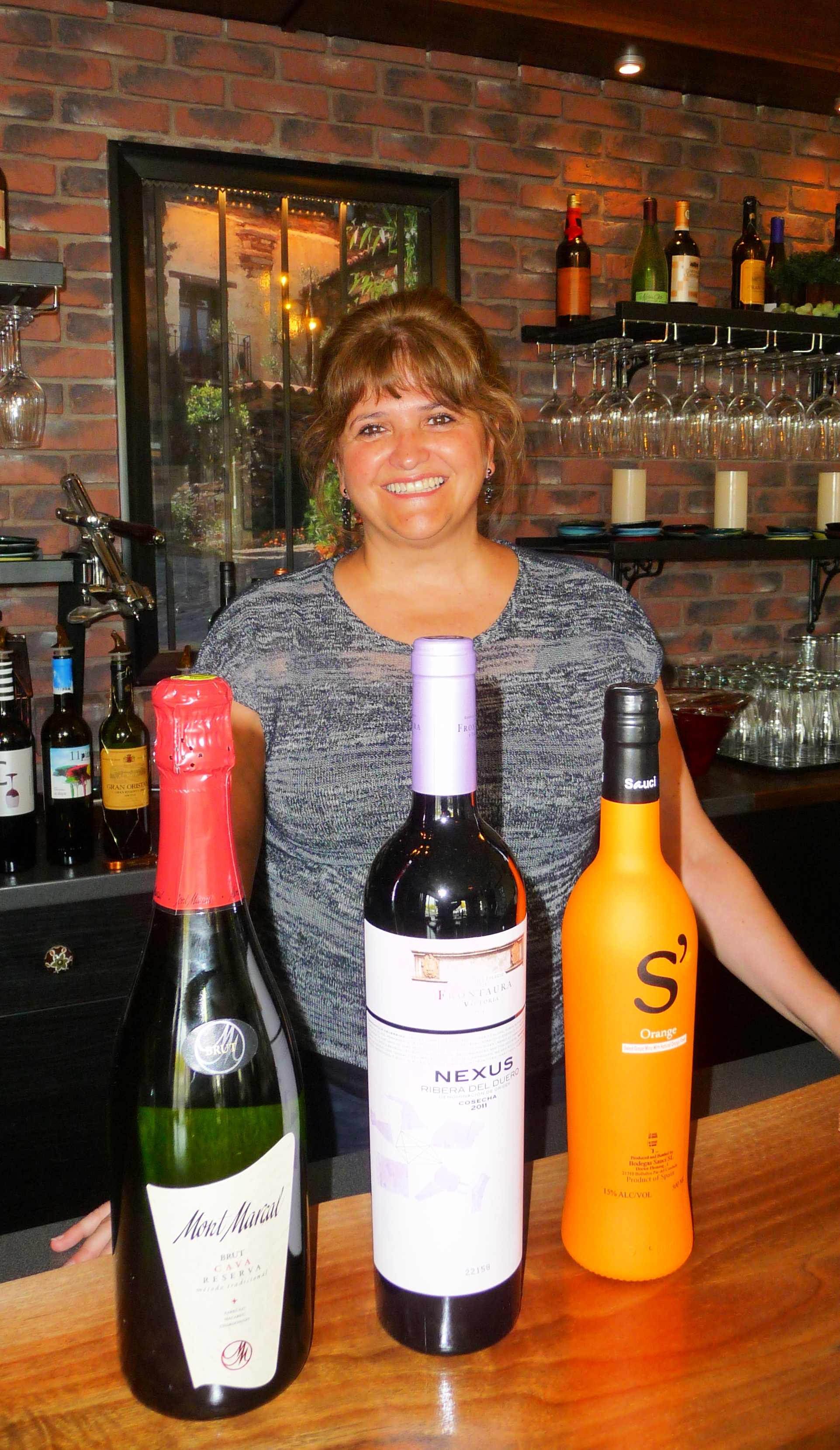 Mar Meyerhoefer, Madrid native and co-owner of Emanar Cellars, with a selection of their top-selling Spanish wines