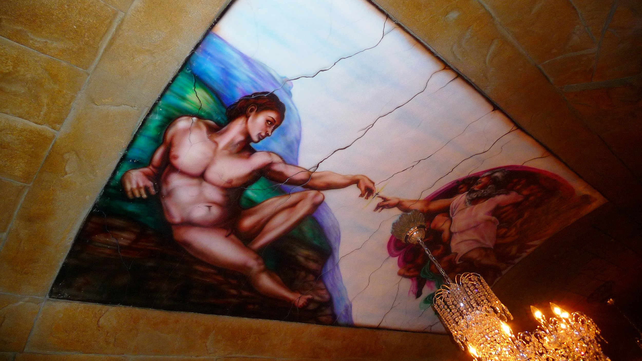 A replica of Michelangelo's Creation of Adam in the exquisite event space inside the wine cave of Reustle Prayer Rock Vineyards