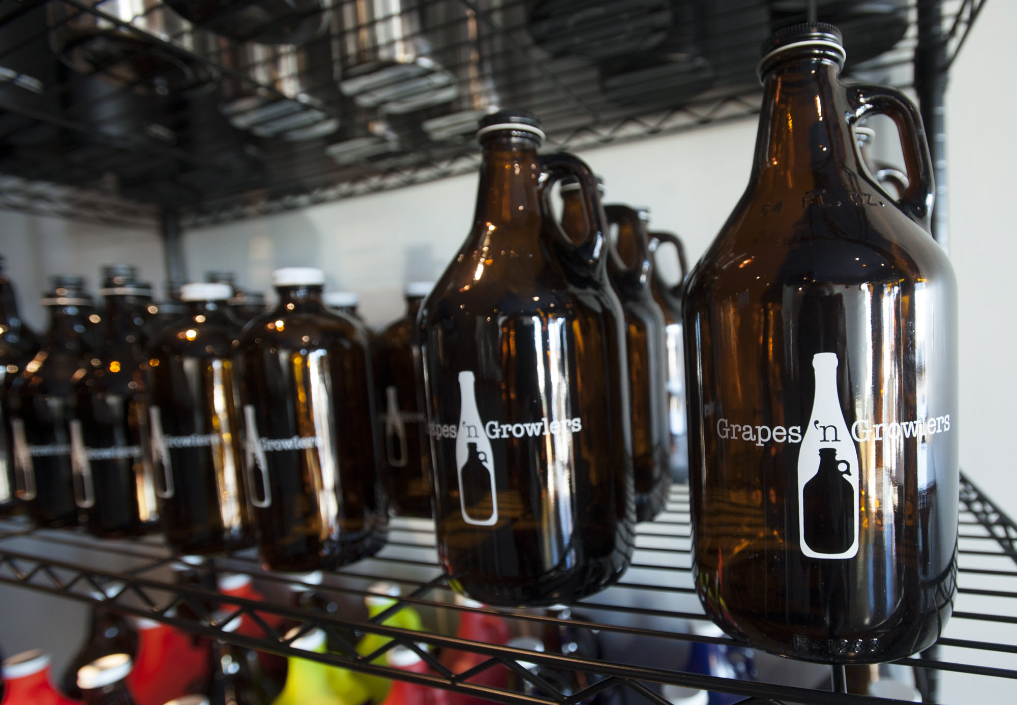 Wine and beer growlers are for sale at the new Vancouver tap room, Grapes 'n Growlers. (Natalie Behring/The Columbian)