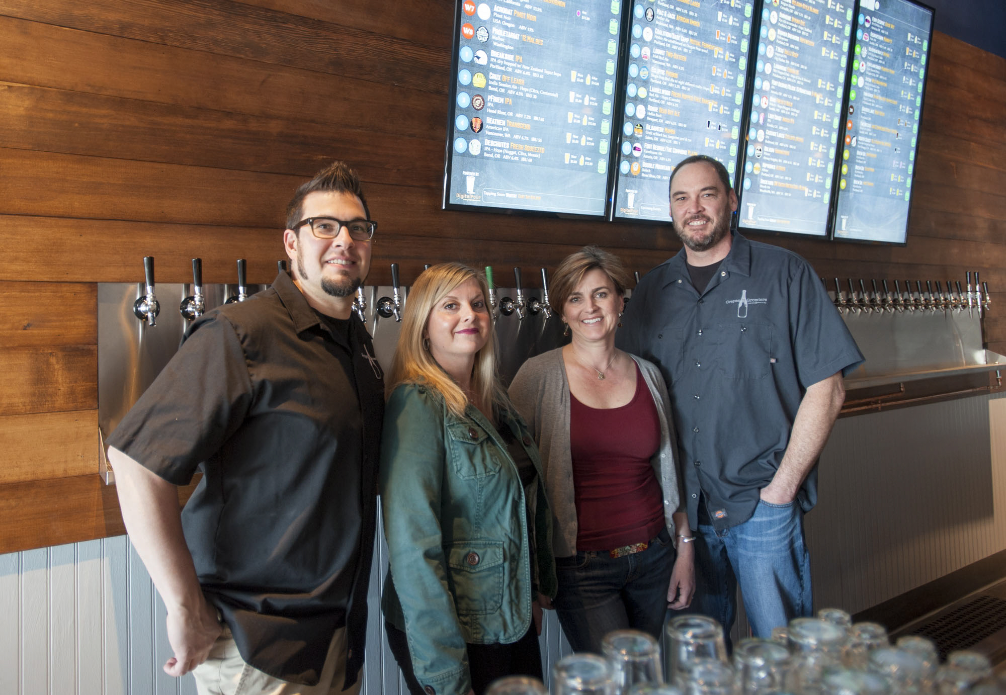 Owners of the recently-opened Vancouver tap room Grapes 'n Growlers (L to R) Ashley Cahoon, Amanda Barnett Cahoon, Paige Mahoney, and Tom Mahoney. (Natalie Behring/The Columbian)