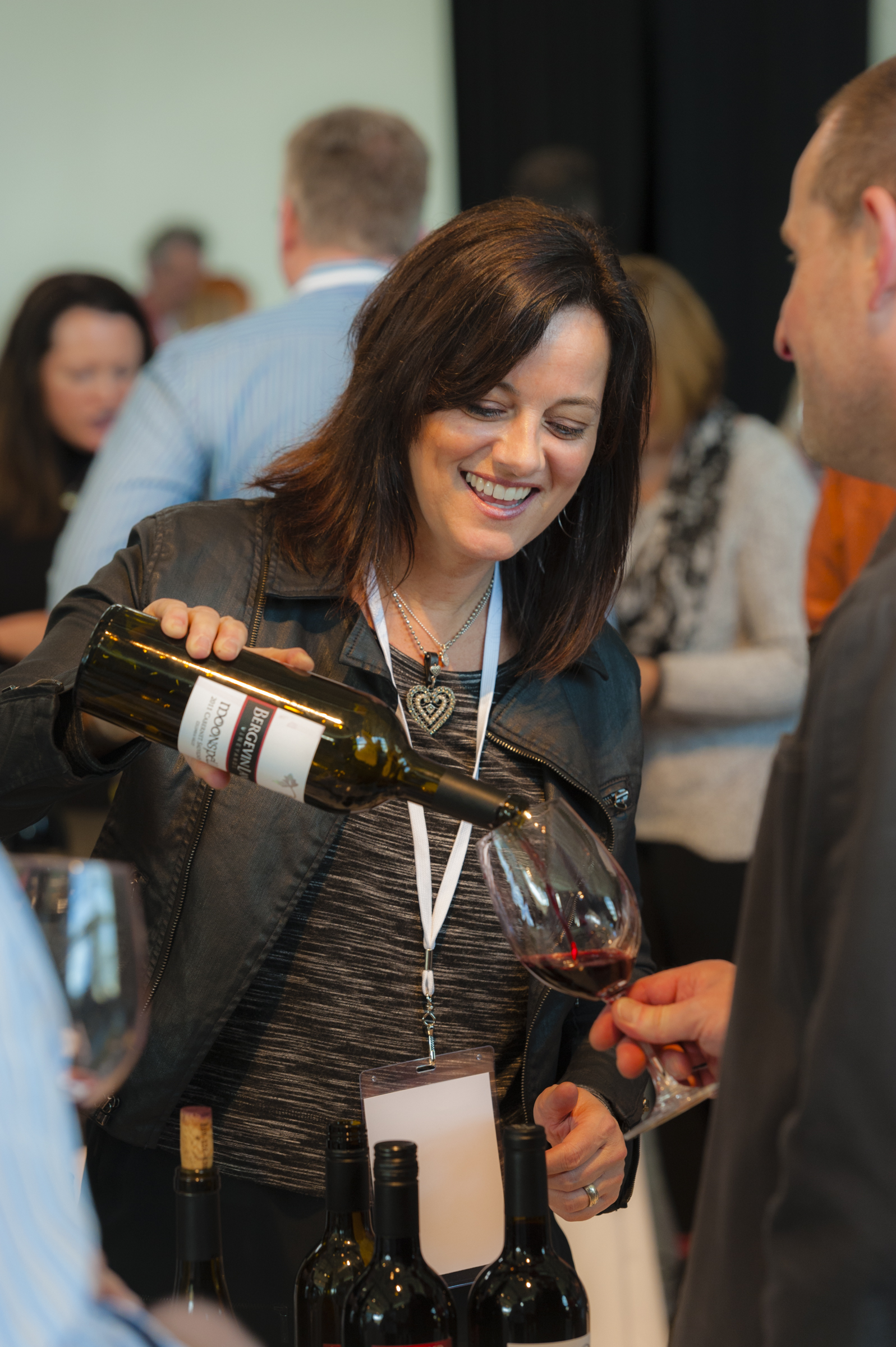 Annette Bergevin, with her signature inviting smile, pours a sampling of Bergevin Lane Vineyards 2011 Moonspell Cabernet Sauvignon. Photo courtesy of Walla Walla Valley Wine Alliance/Richard Duval Images.