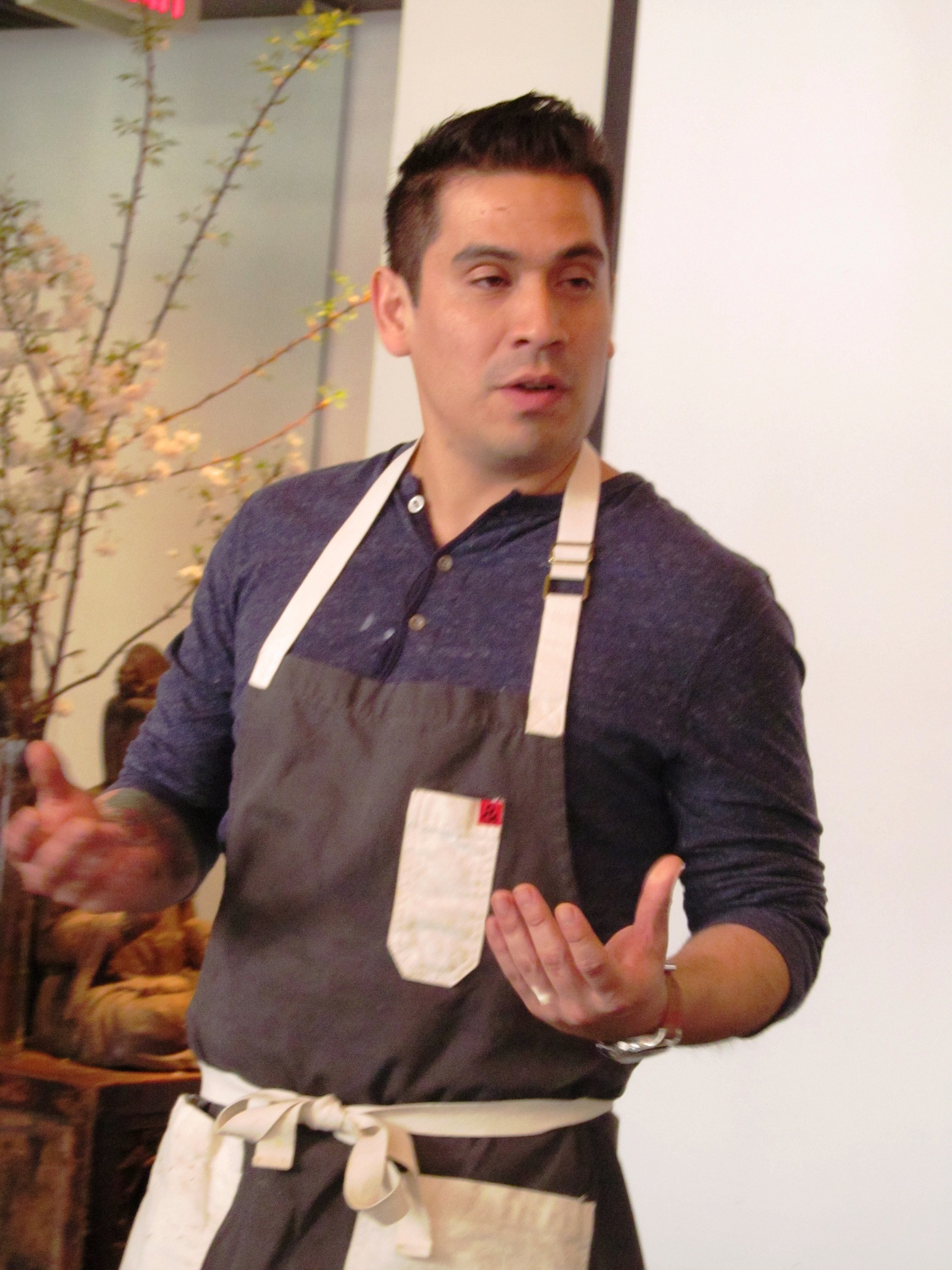 Peruvian-born and Pan-Asian trained chef at Saucebox, Alex Diestra, explaining his culinary creations to an appreciative audience. Courtesy of Wine Yakima Valley.