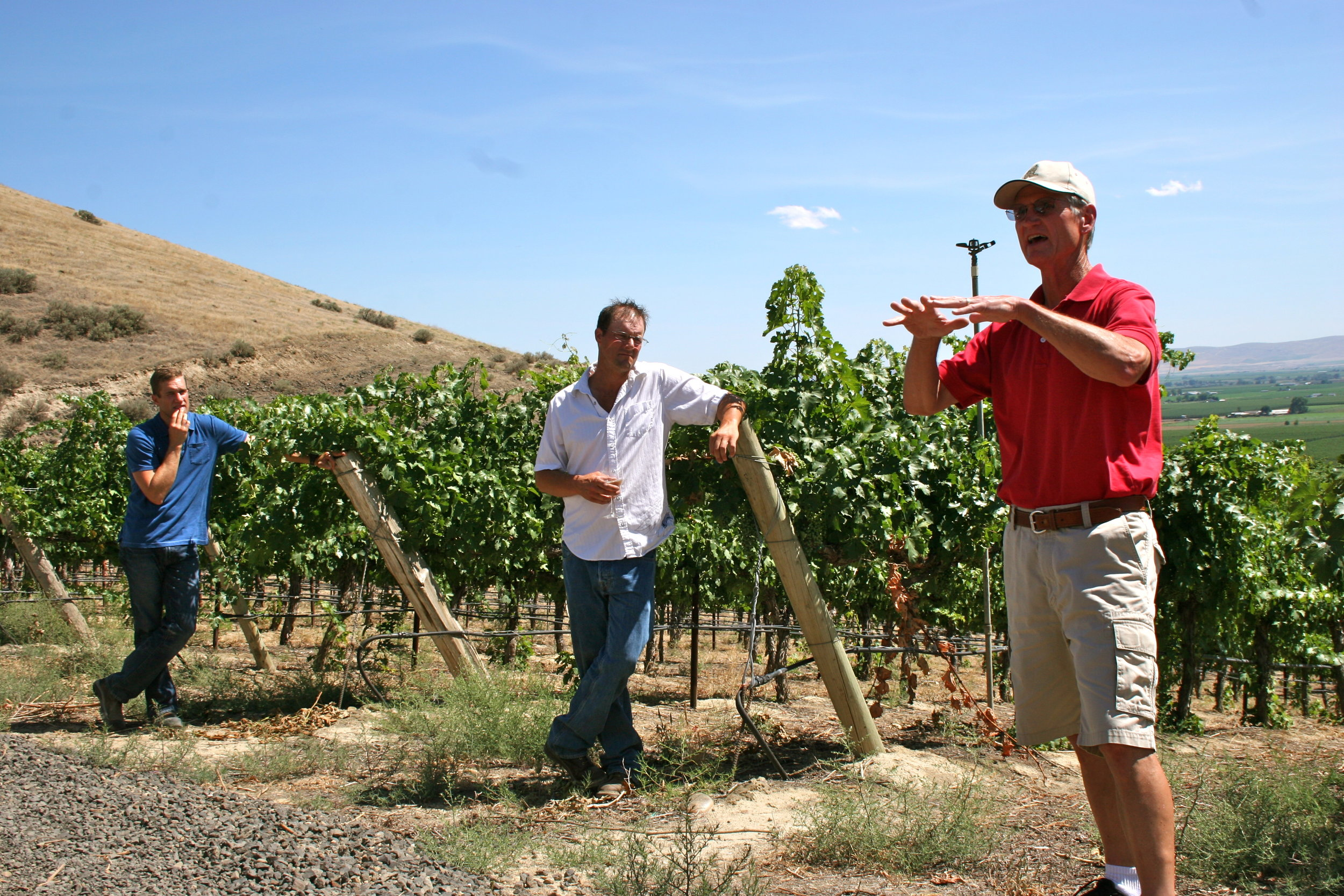 Wade Wolfe, winemaker at Thurston Wolfe (in red), with Todd Newhouse of Upland Winery and John Martinez of Maison Bleue Winery. Courtesy of Wine Yakima Valley.