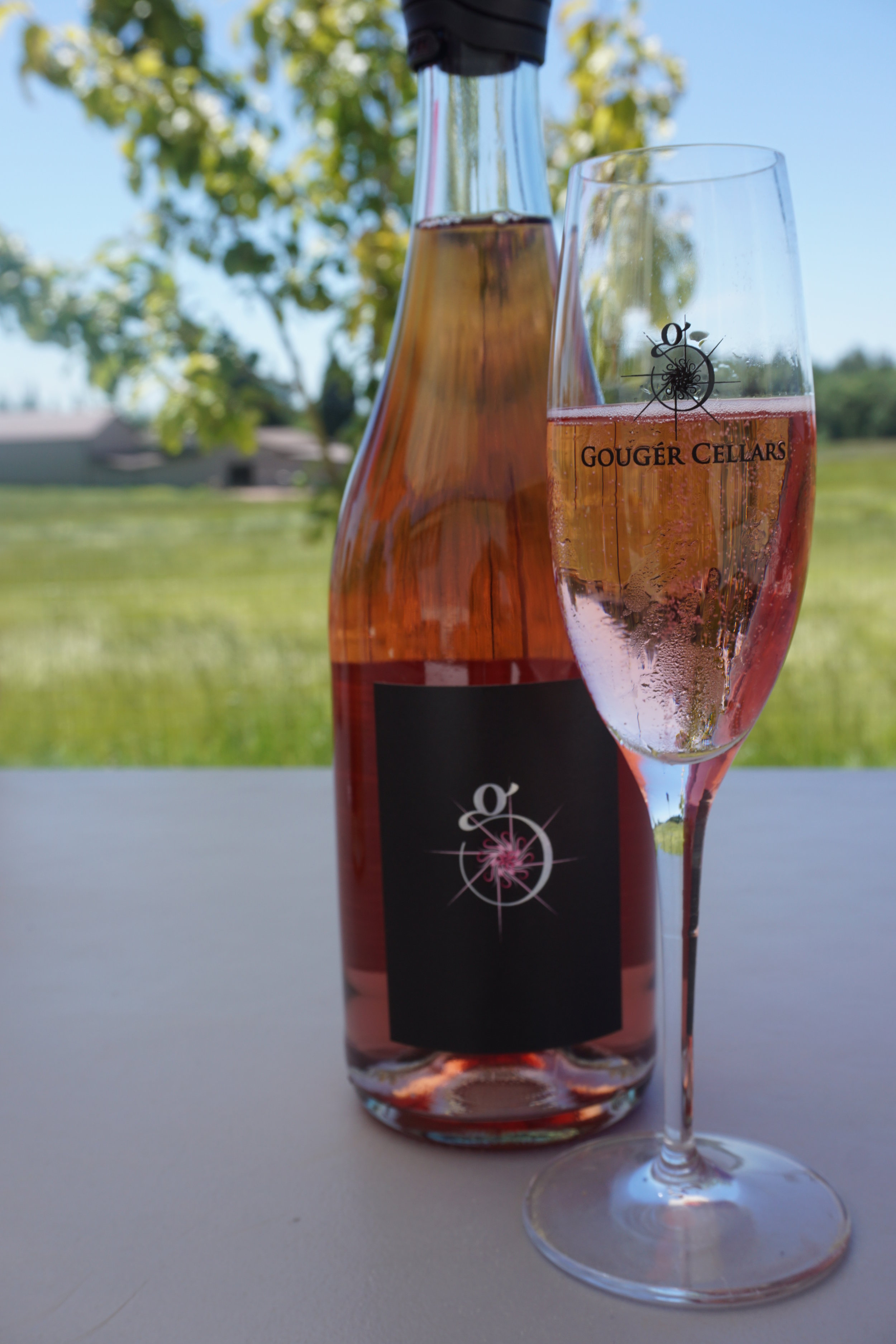The strawberry appearance of Gougér Cellars Sparkling Rosé is followed up by a nose of strawberries and a mouth of crisp acidity, ripe raspberry, strawberry and a hint of rhubarb.