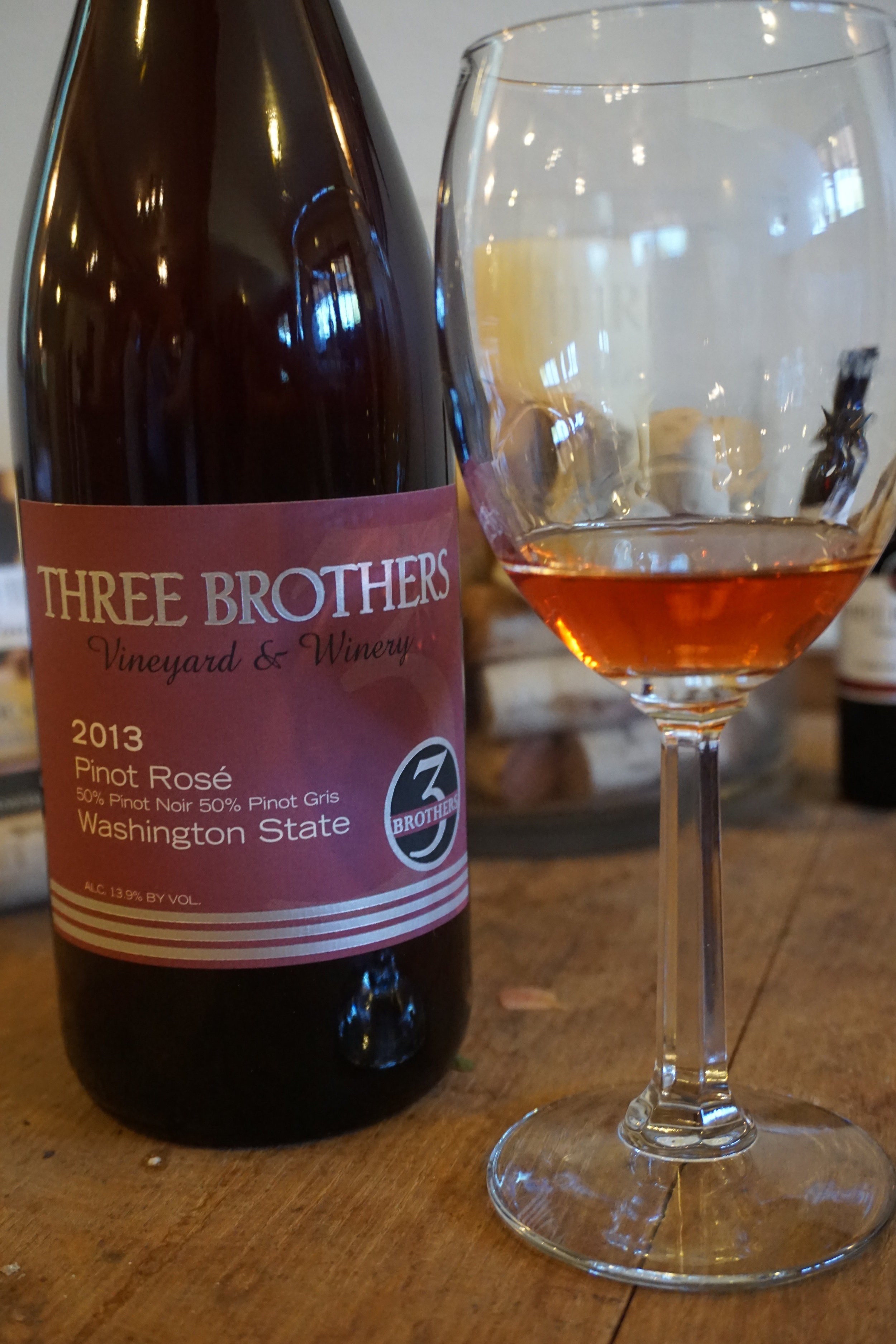 The salmon pink color of Three Brothers 2013 Pinot Rosé gives way to a true pinot noir nose of ripe raspberry and cherry with enough white pepper finish to keep this sweeter rosé from being cloying.