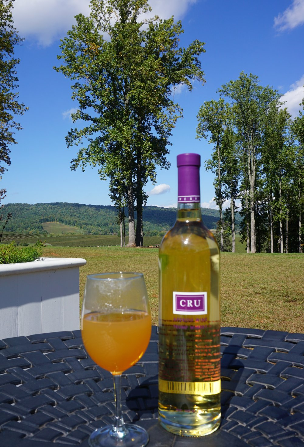 Trump Winery specializes in sparklings but it was the Cru—a chardonnay fortified with brandy and aged in American bourbon barrels—that I sipped on under a stand of evergreens soaking in the breathtaking Virginia view.